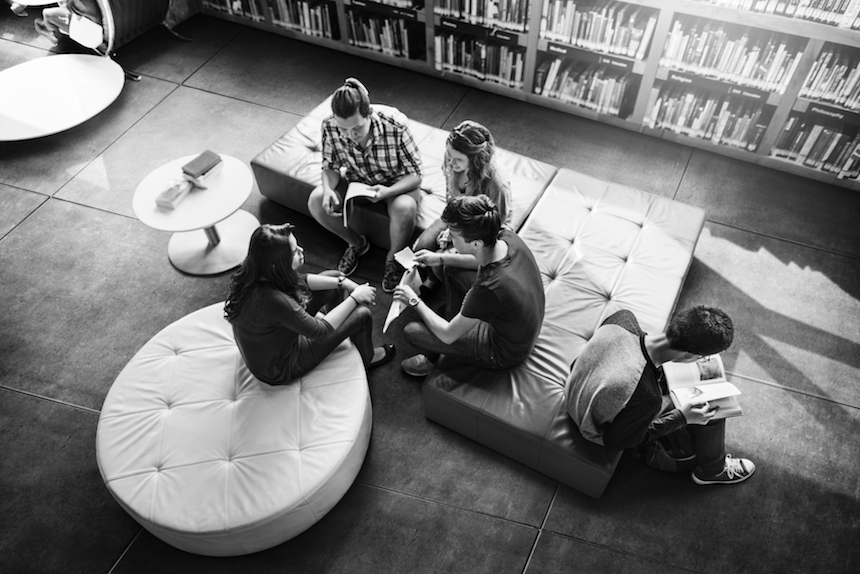 Group of young people in a library. (Source: Rawpixel.com)